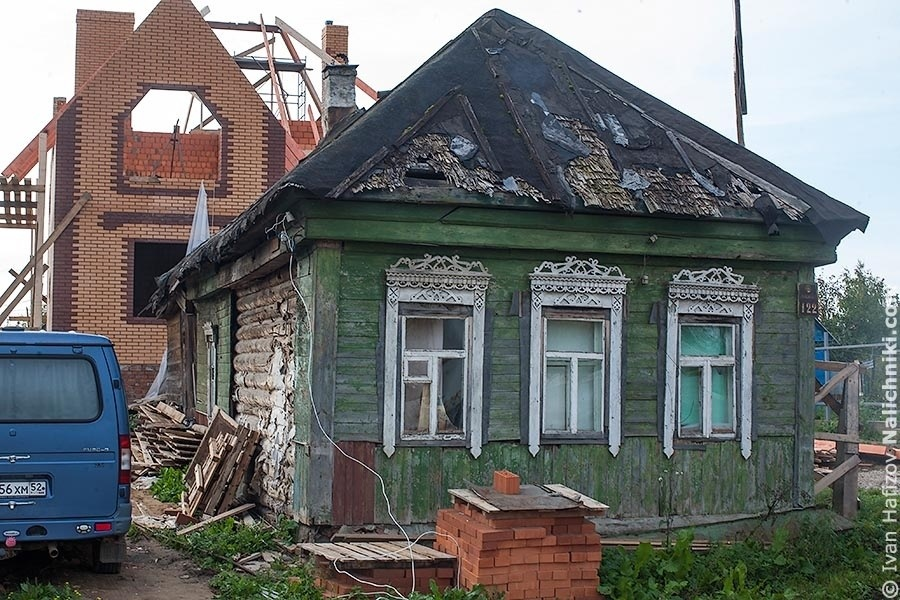 Old wooden house with broken roof