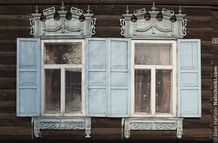 A pare of wonderful ornate wooden window frames in the city Chita