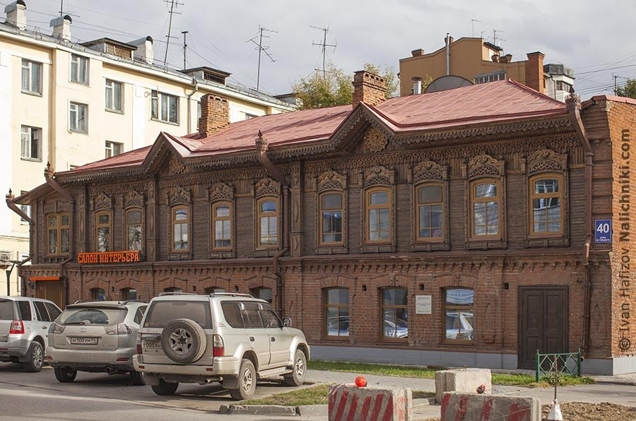 On of restored wooden house ornated with carved wood in Novosibirsk