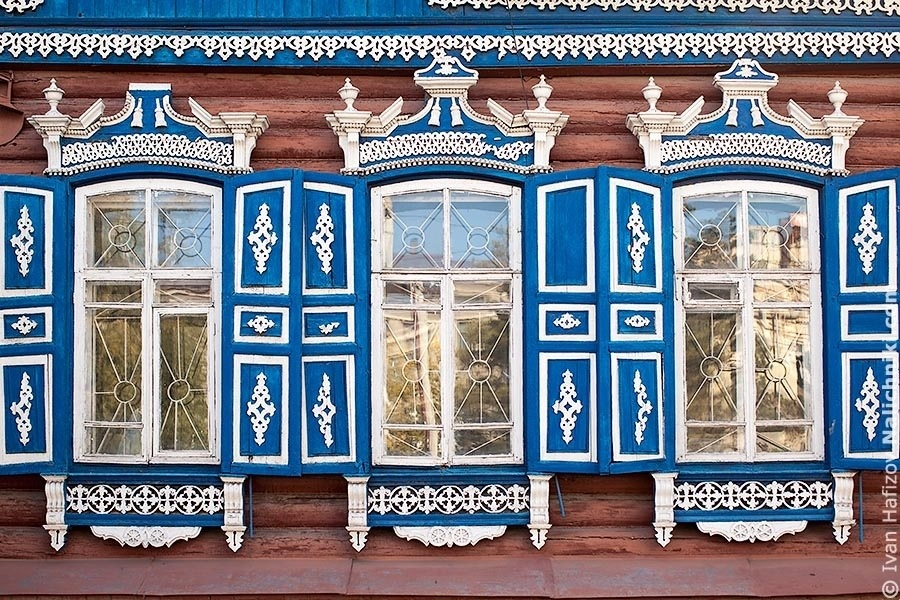 Three window witn nalichniki (old decorative russian window frames) in Omsk