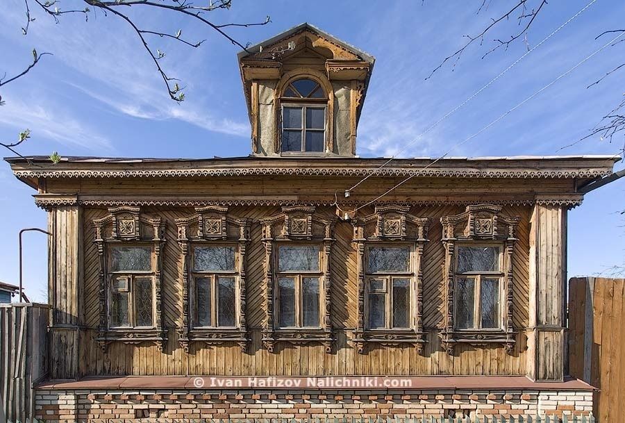 Five traditional ornate wooden windows frames of wooden house in Kirov city