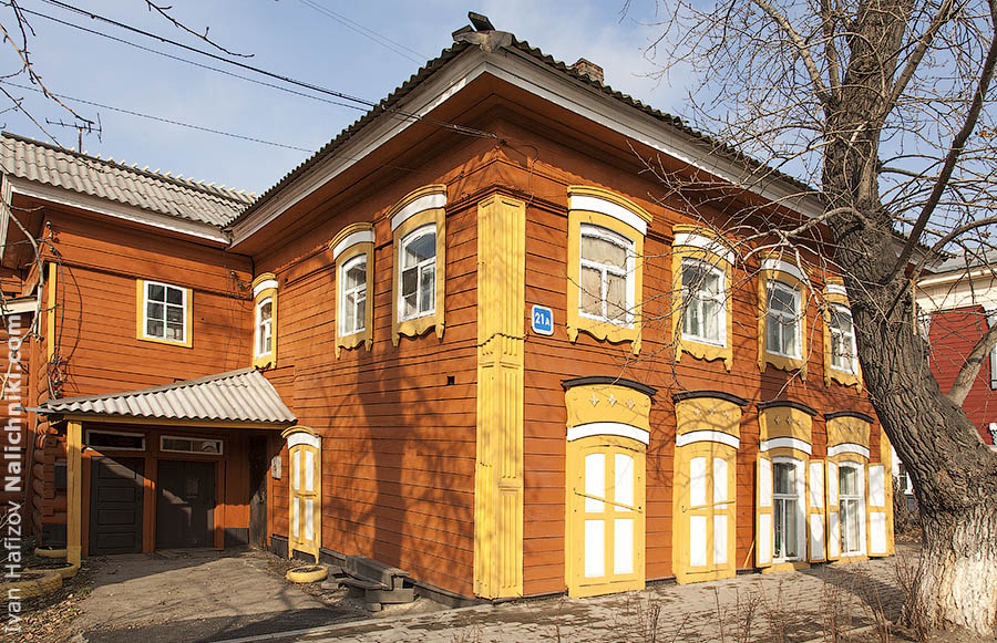 Good-looking and bright colored wooden house in Irkutsk.