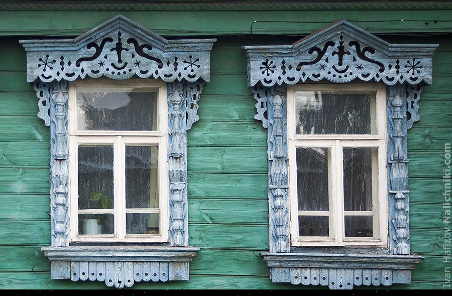 Nalichniki (old Russian window frames) decorated with candles