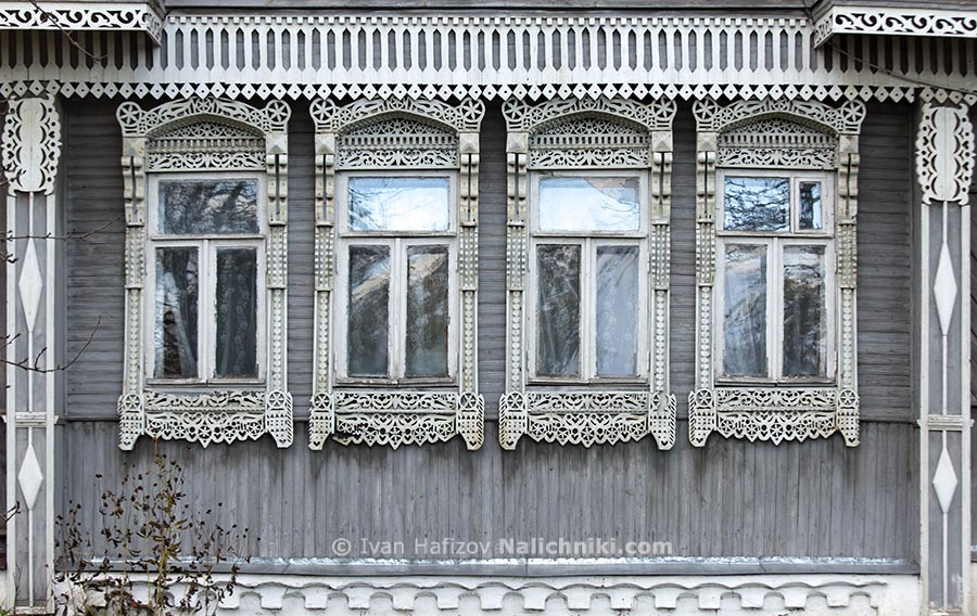 Four grey ornate wooden windows frames(nalichniki)
