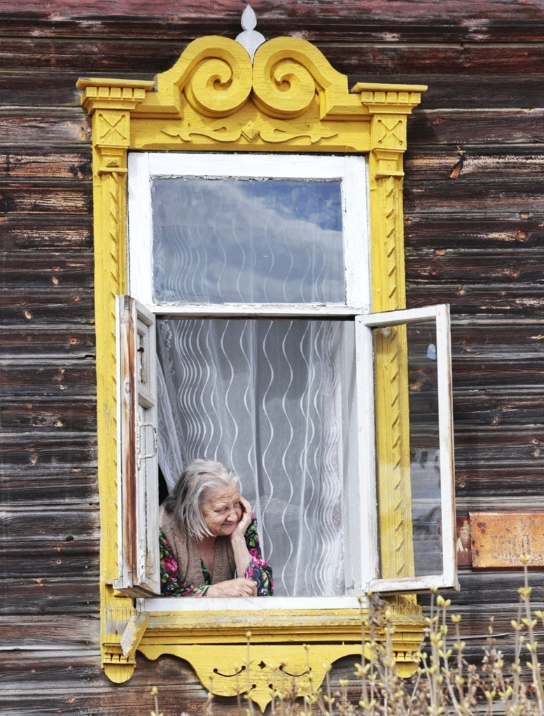 An old lady in a window