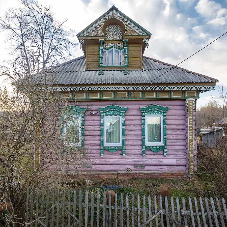 Decorated with fretwork wooden house in traditional Russian style