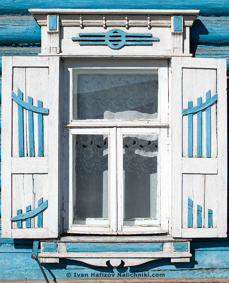 Omsk's city Nalichniki (ornate wooden windows frames) with shutters and with strange symbol