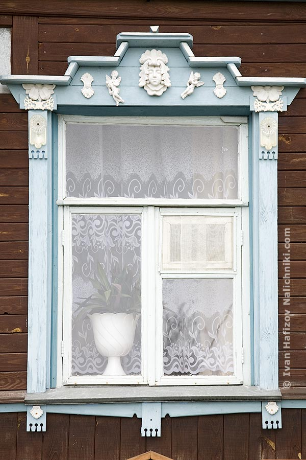 Traditional Russian nalichnik (ornated wooden windows frames)