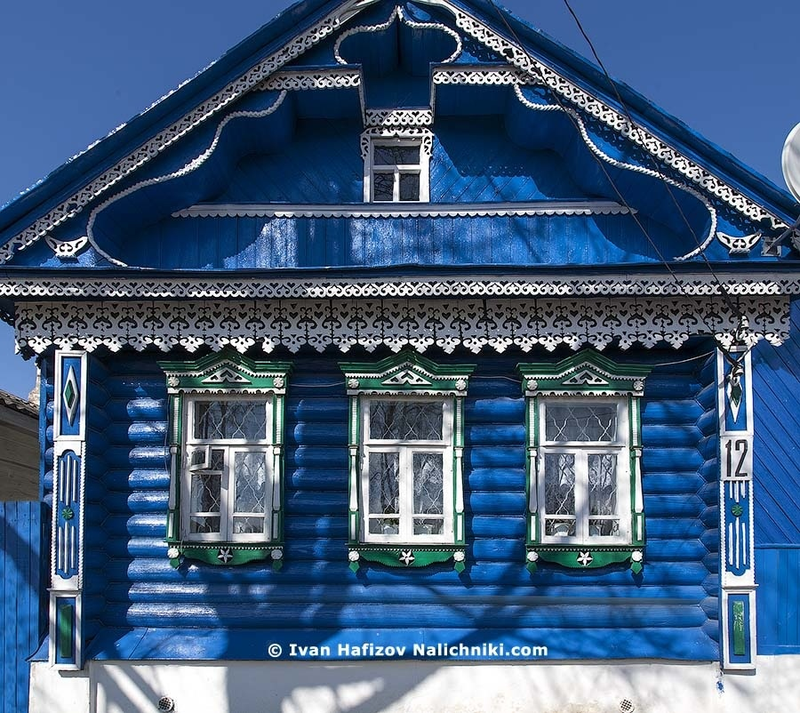 Beautiful bright blue log-house with nalichniki