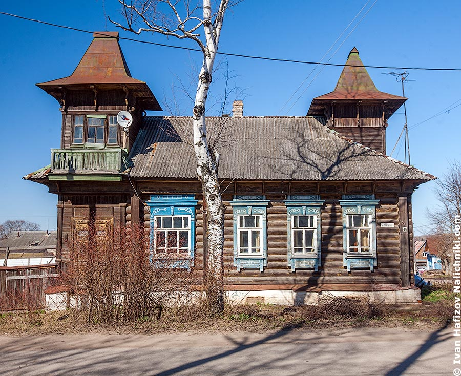 Wooden house with fretwork and turrets