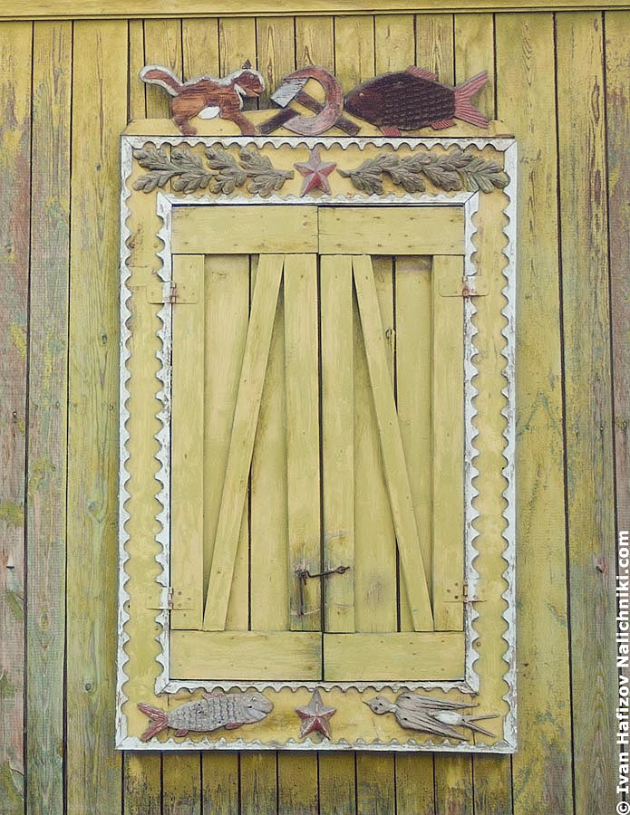 Closed window with shutters, decorated with bird and squirrel