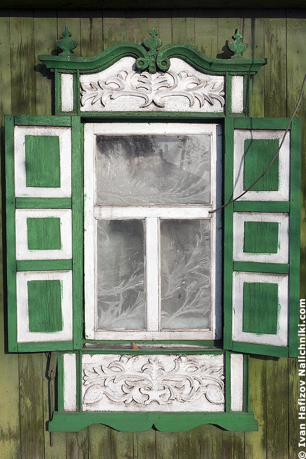 Usual Nalichnik with shutters decorated with fretwork in Tumen city