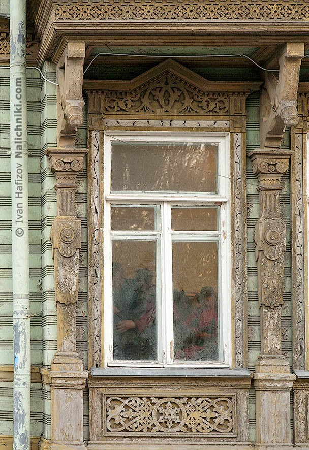 Wooden window frame with ornamental pattern