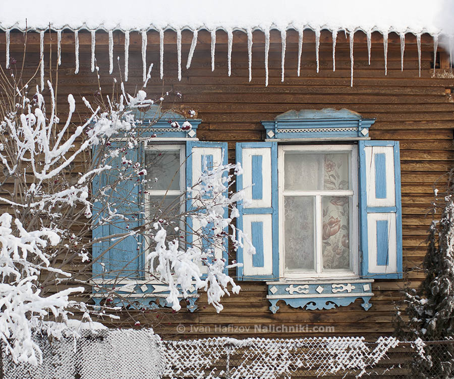 Traditional Russian window frames with shutters