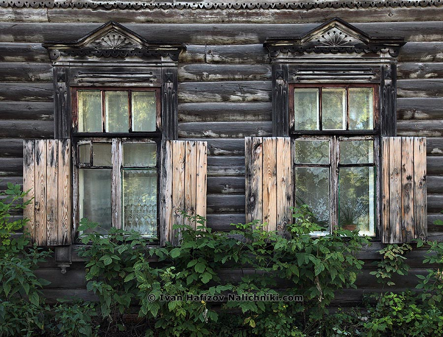 An old Black wooden window frames