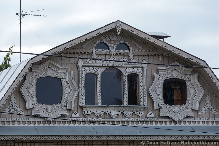 Carved decoration of windows at second floor of a stone made house in Kolomna