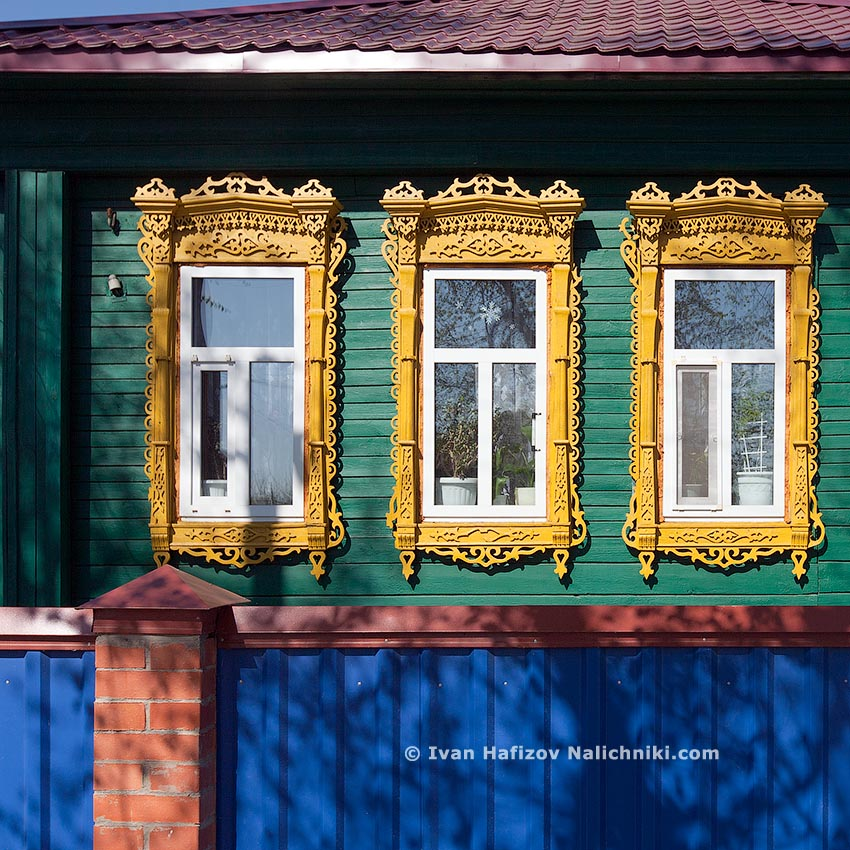 Plastic windows decorated with Wooden window frames
